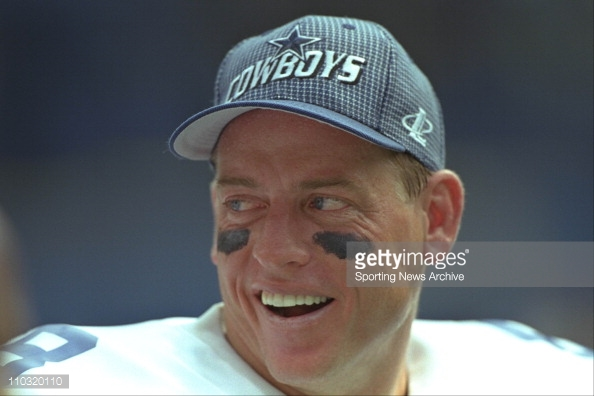 Troy Aikman shares a laugh with teammates in the closing stages of Dallas' blowout victory over Pittsburgh.