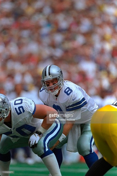 Troy Aikman, preparing to take the snap from center Clay Shiver, tied a career-high with four touchdown passes on opening day versus the Steelers.