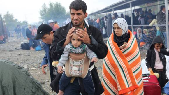 europe-refugee-crisis-father-and-baby-caritas-greece_opt_fullstory_large