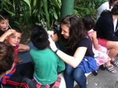 April 2015 - Nicole painting some faces at a local children's home where a family has been taking in abandoned kids, adopting them, and raising them for more than 40 years.