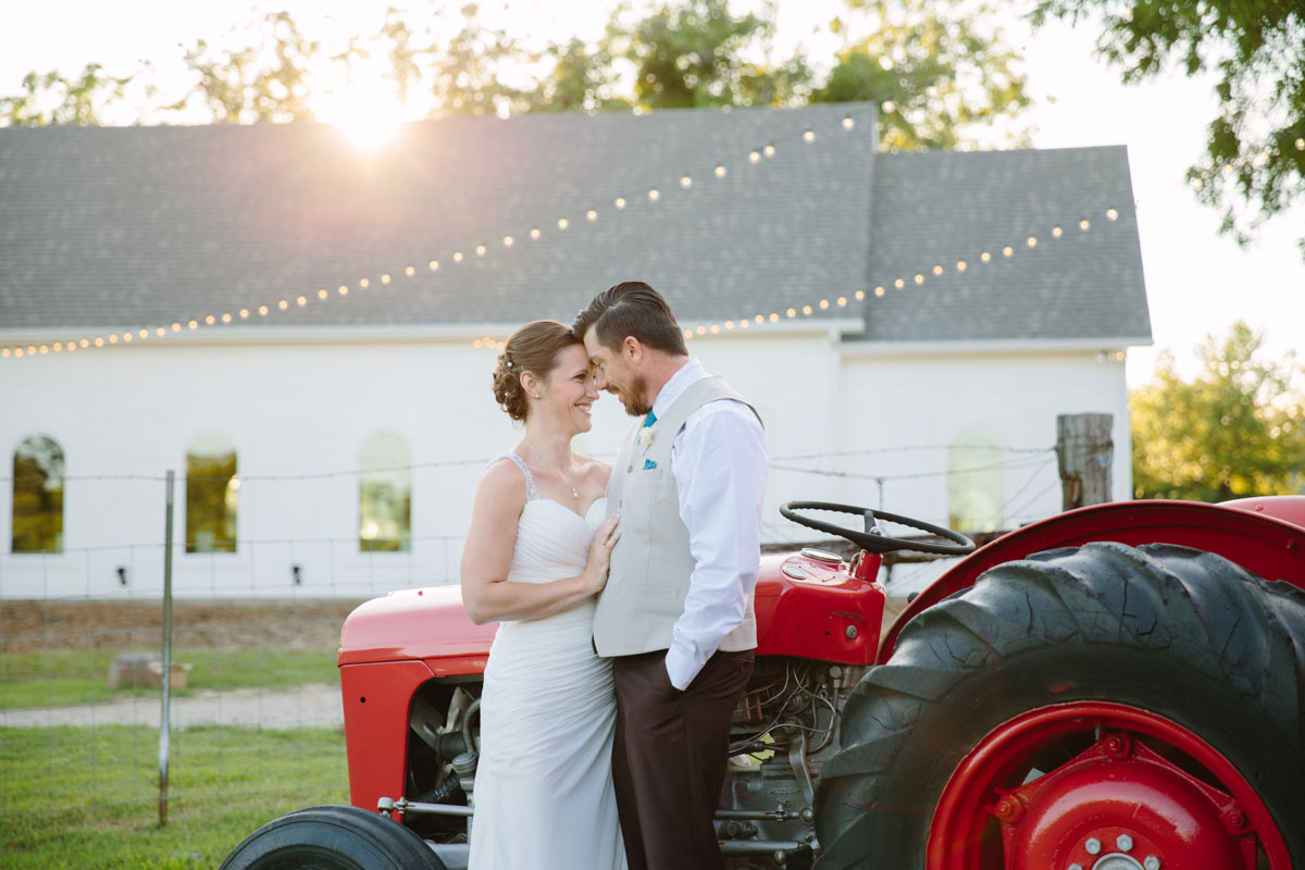 dallas wedding photographer captures bride and groom by tractor