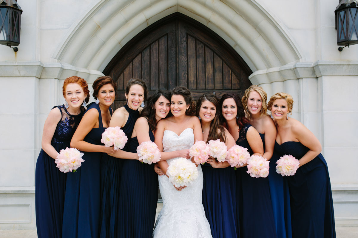 Navy Bridesmaid dresses with Blush flowers at the caslte wedding venue