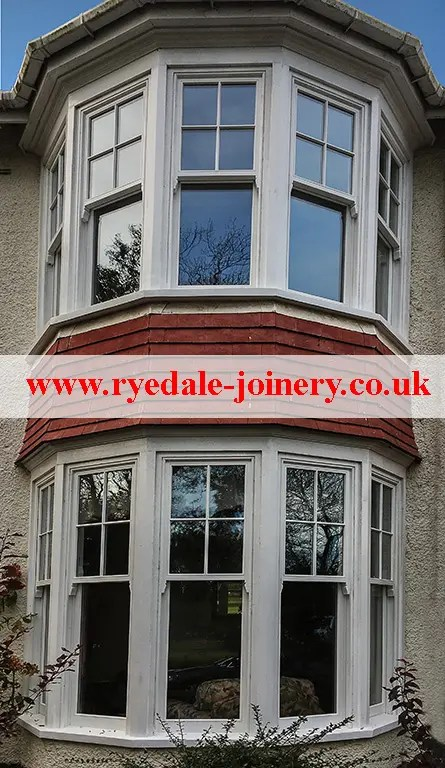 An image of the front of a house showing sash windows both upstairs and downstairs.