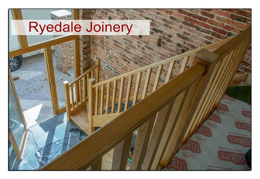 Elegant oak staircase fitted within barn conversion.
