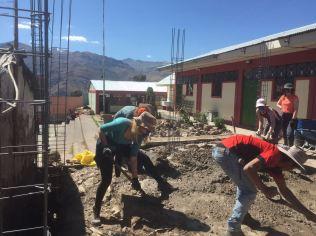 Team members mixing concrete