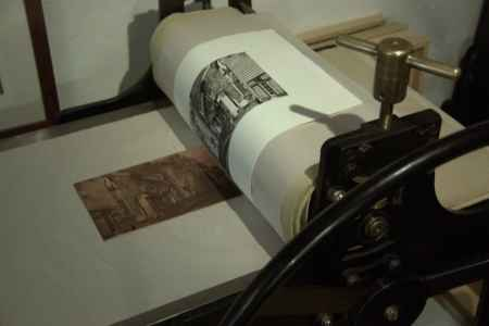 After running through the press gently roll the blankets over the rollers and fpeel the still damp paper off the plate being careful not to smear the ink.