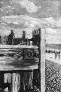 RYE BAY GROYNES 2 weathered wooden groyne buried in the shingle at Winchelsea Beach near Rye