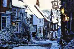 SLIP DOWN MERMAID STREET, RYE Snow covering Rye's most famous street. A slippery trip down the icy, cobbled Mermaid Street, past the snow dusted sign of the Mermaid Inn on the right, and on to the orange glow of lights in the windows of Jeakes House. One of the first giclée prints produced after moving to Hastings in 2005