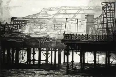 SMOKE ON THE WATER - Hastings pier continues to smoulder, wreathed in smoke the morning after the fire in October 2010. Etching by Colin Bailey