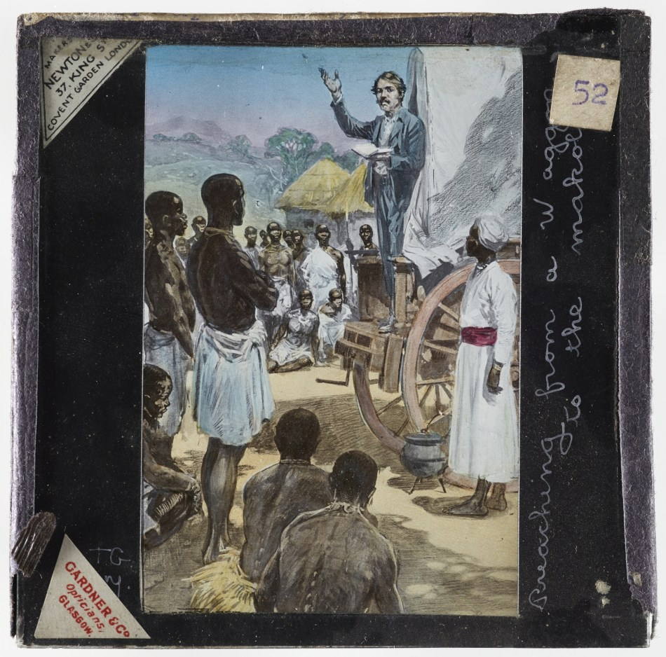A magic lantern slide illustration of David Livingstone's missionary work in southern Africa. The slide depicts Livingstone preaching from the back of a wagon in a Makololo village.