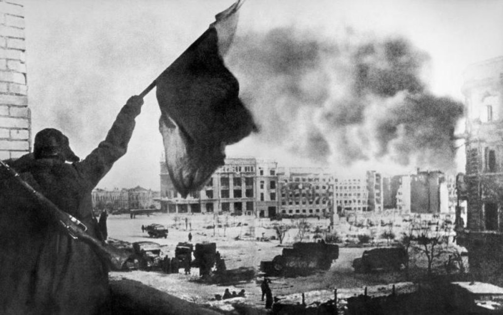 Picture of Red Army soldier in Stalingrad waving the red flag in 1943