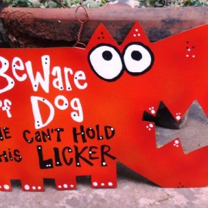 dog can't hold licker metal sign