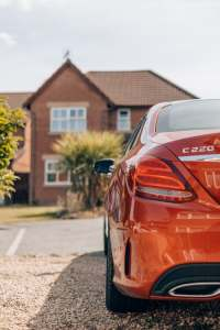 C220 Red Car with House