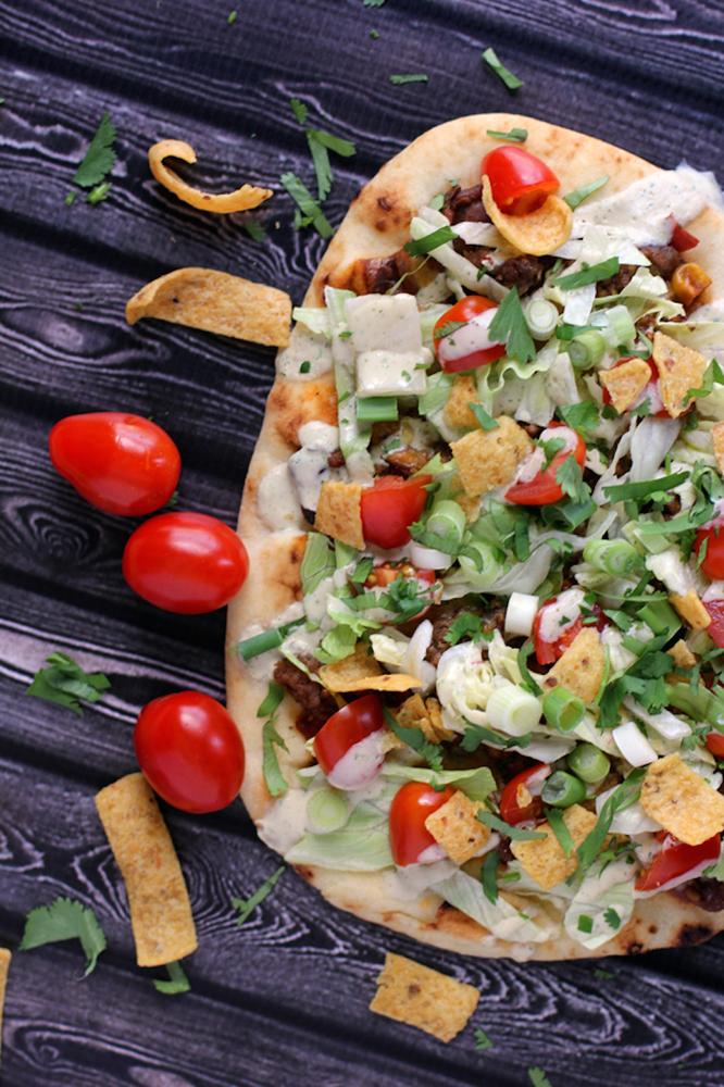 "<strong>Get the <a href=""http://melaniemakes.com/blog/2014/05/taco-frito-flatbread-pizza.html"" target=""_blank"">Taco Frito Fla"