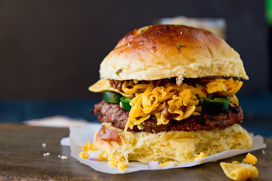 "<strong>Get the <a href=""http://www.jasonandshawnda.com/foodiebride/archives/11505"" target=""_blank"">Frito Pie Burger recipe</"