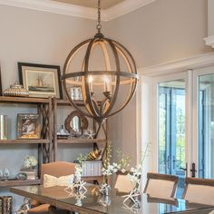 Steel Frame Construction Provides The Framework For Detailed Wood Carvings Of This Chandelier