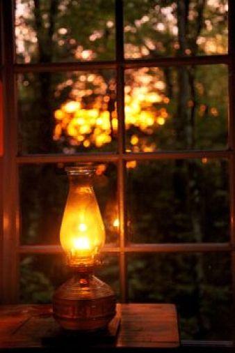 Image result for kerosene lantern light in cabin at night