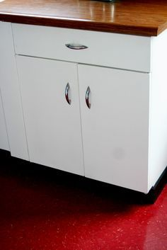 White Metal Cabinets With Wood Countertop Learning To Love My 50s Kitchen