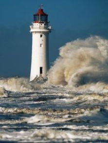 Image result for image of lighthouse surrounded by sea