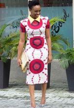 Chimamanda Ngozi Adichie cute outfits - Pink, Purple and White Sheath dress, and yellow blouse