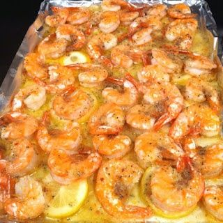 SHRIMP…Melt a stick of butter in the pan. Slice one lemon and layer it on top
