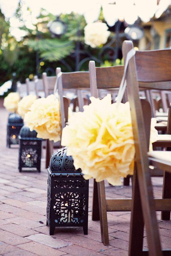 pom-pom aisle decor—Cheaper than flowers!