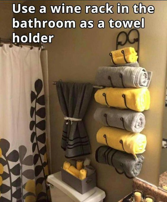 Install a wine rack in your bathroom to store towels.