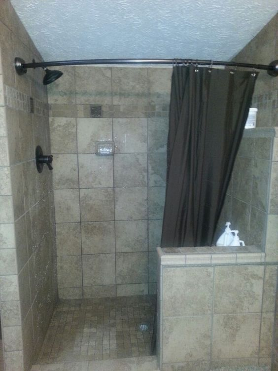 Tile Shower With Curved Shower Curtain And Half Wall