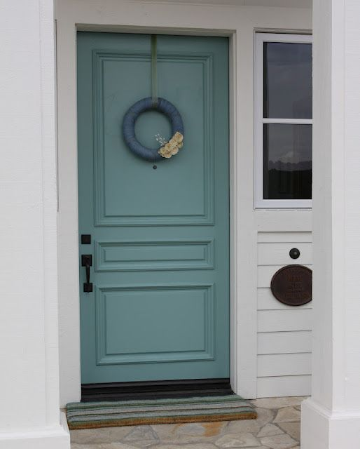 I think I could totally get away with painting the front door this color! sherwin williams drizzle: