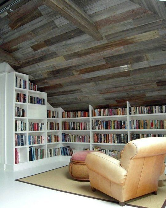 What a lovely way to use an attic space! While tablets and pads are overtaking paper, I still love a good library!: