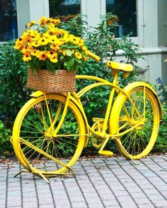 Yellow upcycled bicycle planter