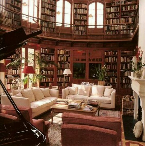 Okay this is a personal dream of mine! Oh my goodness double story library, gorgeous family room, and grand piano?! Yeah!: