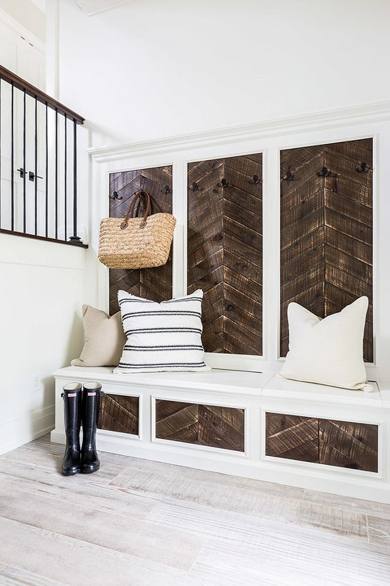 Love the reclaimed wood accent on this built-in! The herringbone style is beautiful. | 100+ Beautiful Mudrooms and Entryways at Remodelaholic.com: