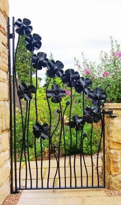 Garden gate: posting this because I grew up in my grandfather's wrought iron factory. He would have killed for a commission like this.:
