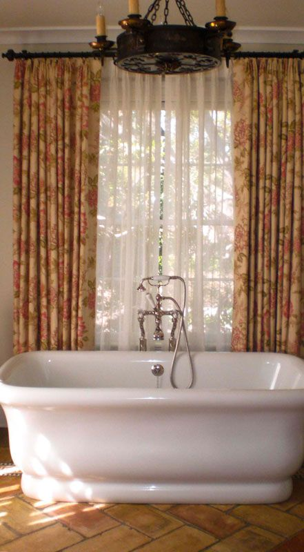 Closing Drapes With Sheers Behind On Wood Poles With RingsThe Floral Print And Sheer Adds A