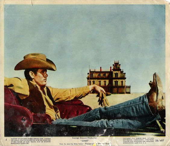 "This iconic image (above) of James Dean as Jett Rink coolly stretched out in front of the Reata Ranch house in George Stevens' 1956 masterpiece ""Giant"" was the inspiration behind Levi Strauss' legendary 1981 ""Travis"" ad campaign and television commercial that launched the 501 jean for women. –Image © Floyd McCarty:"