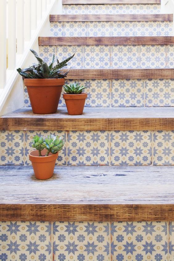 Fresh look on wood stairs with fun tile on risers. Will help cover up any damaged risers and becomes the focal point.: