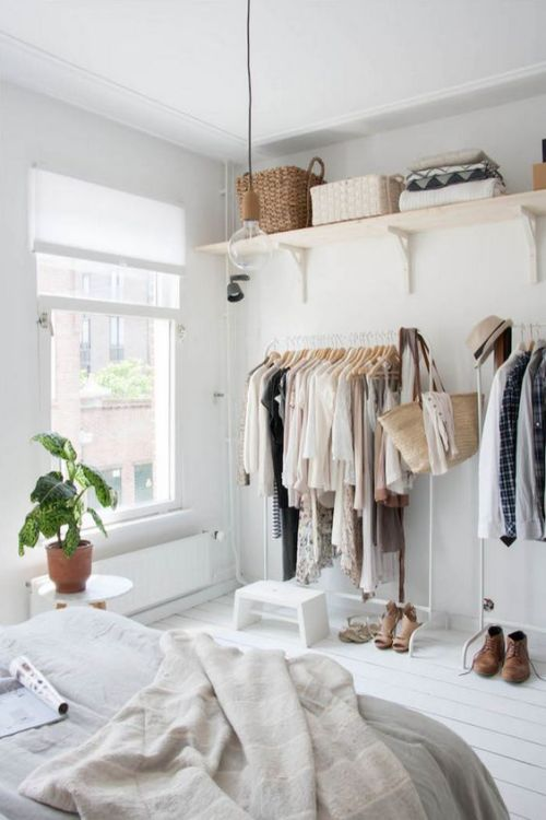 Closet Organization Clothes Organized by Color Pendant Light Hanging Clothes Shoes