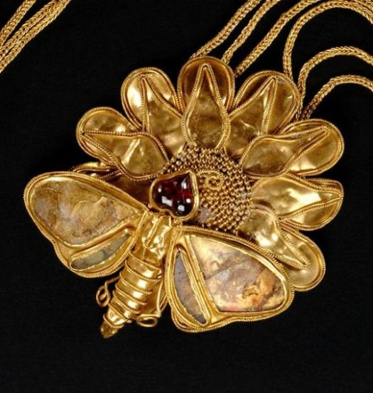 Greek Gold and Garnet Butterfly Necklace, Late 4th-3rd Century B.C.(The body of this insect looks like the delineated body of the bee to me; instead of a butterfly.)