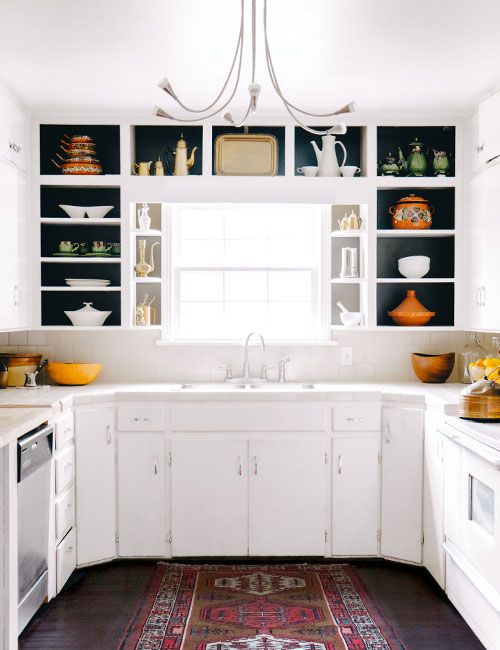 Love these open kitchen shelves with the backs painted black |via DesignSponge.com: