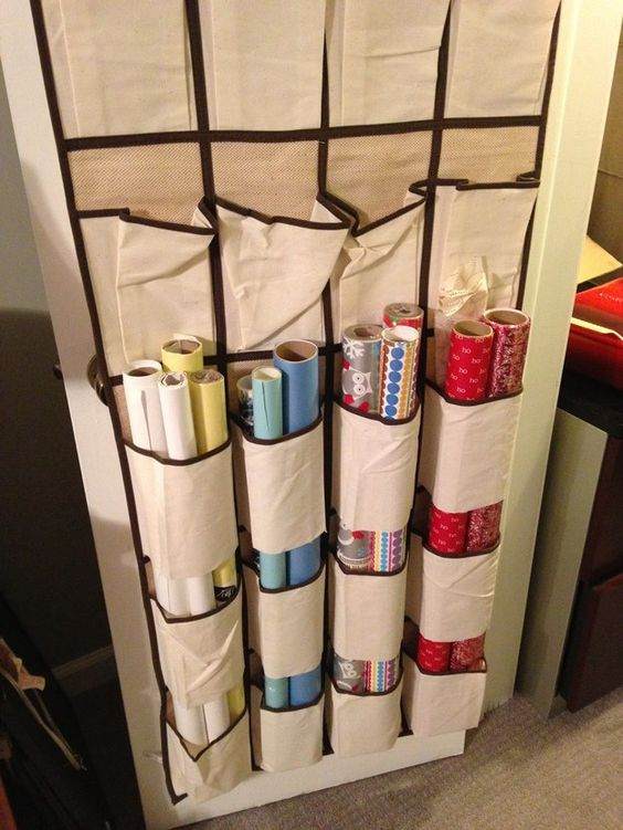 25 ingenious ways to use shoe bags (but not for shoes)! Cut the bottoms off of 2 rows to hold tubes of wrapping paper.