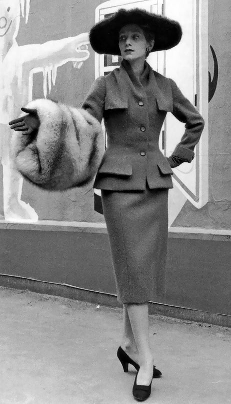 1954 - Christian Dior's wool town suit worn with fur hat & fox muff photo by Willy Maywald: