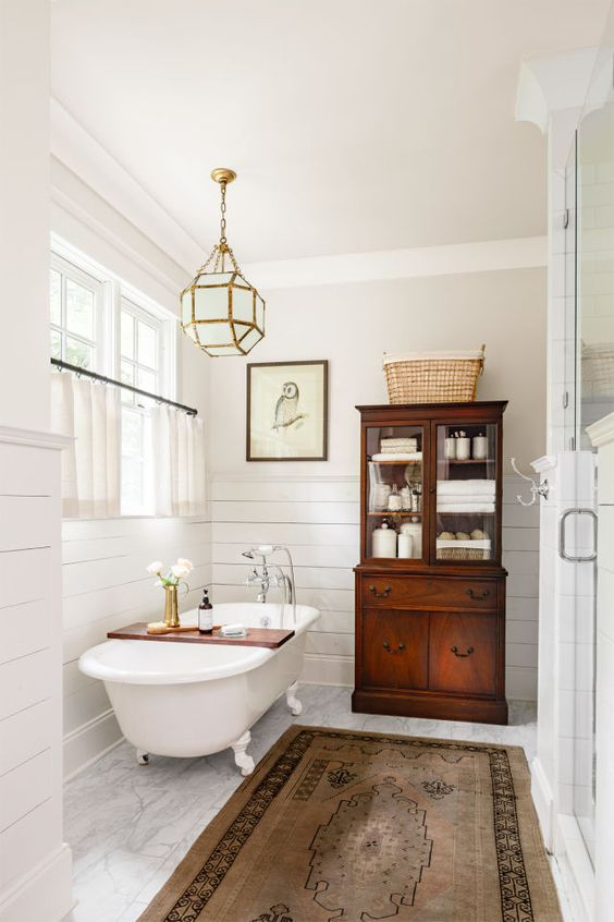 Passed down from Mandy's grandmother, an antique mahogany china cabinet­ makes a striking, unexpected statement—so much so that it almost overshadows 