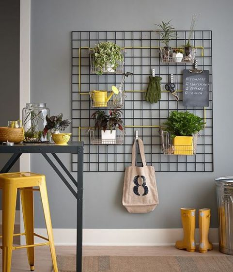 Hang kitchen baskets on a mounted wall trellis