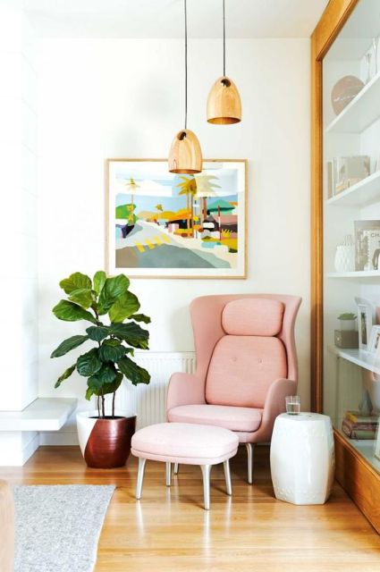 pink armchair& foot stool plant & pendant lights: