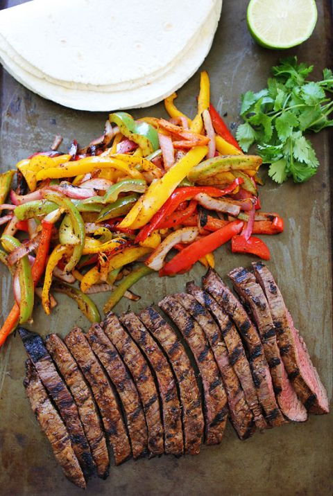 "Grilled Steak Fajitas Recipe | Two Peas & Their Pod ""Get out the grill and make grilled steak fajitas with sizzling peppers and onions! Serve with flour tortillas and your favorite toppings!"""