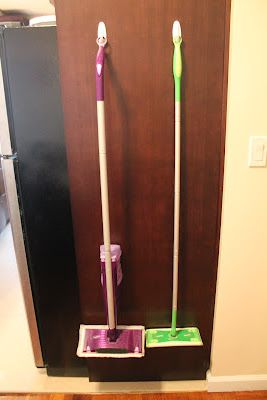 Use Command Hooks to hang your Swiffer mop. Genius! I could do this to the inside of one of the pantry doors and put baskets on the inside of the other!: