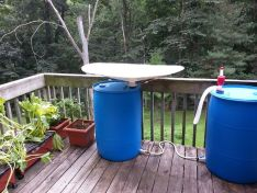 RainSaucers - To collect rainwater on a balcony for watering plants.: