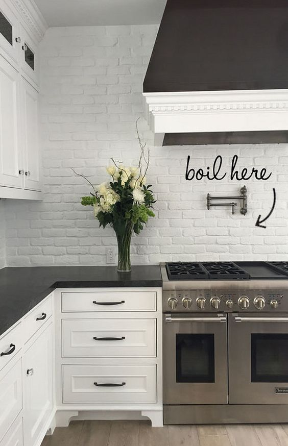 Brick Backsplash. Kitchen Brick Backsplash Painted in White. Transitional kitchen with white painted brick backsplash and honed black granite countertop. #Brick #Backsplash #Kitchen #WhiteBrick #paintedBrick Blackband Design.: