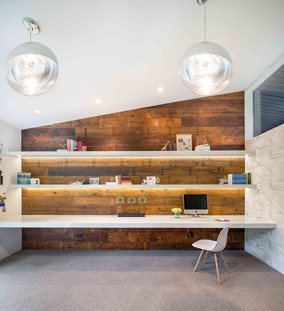 Gorgeously lit shelves and reclaimed wood wall create a stunning midcentury modern home office [From: Vanillawood]: